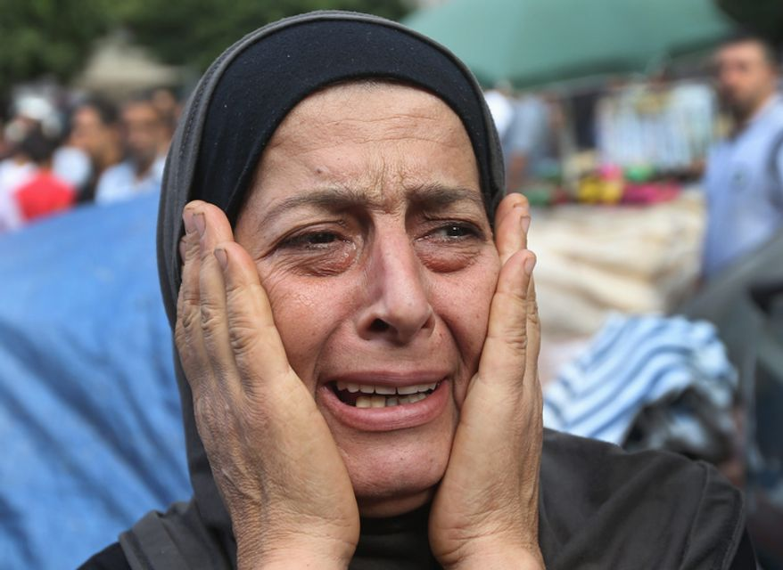 A Lebanese woman mourns Oct. 23, 2012, in the Sunni neighborhood of Tarik al-Jadida in Beirut during the funeral procession of Palestinian Ahmad Queider, 20, who was killed the previous day during exchange of gunfire between Lebanese troops and gunmen as he rode his motorcycle. (Associated Press)