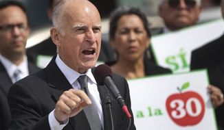 California Gov. Jerry Brown makes a point while speaking in support of Proposition 30 at an elementary school Tuesday, Oct. 23, 2012, in San Diego. Proposition 30 would boost the state sales tax by a quarter cent for four years and raise income taxes for seven years on those who make more than $250,000 annually. (AP Photo/Lenny Ignelzi)