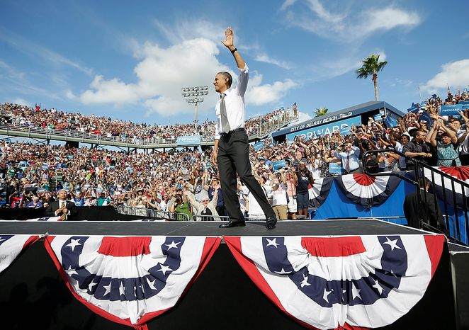 ** FILE ** President Obama waves as he takes the stage at a campaign event at Delray Beach Tennis Center on Tuesday, Oct. 23, 2012, in Delray Beach, Fla., a day after the final presidential debate against Republican rival Mitt Romney. (AP Photo/Pablo Martinez Monsivais)