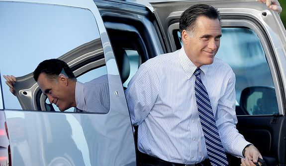 Republican presidential candidate Mitt Romney exits his vehicle before boarding his campaign plane in West Palm Beach, Fla., on Tuesday, Oct. 23, 2012, en route to Nevada for a campaign stop, after the previous evening's final presidential debate with President Obama. (AP Photo/David Goldman)