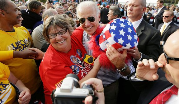 Vice President Joe Biden stops to be photographed with a supporter during a campaign event with President Barack Obama at Triangle Park in Dayton, Ohio, Tuesday, Oct. 23, 2012, the day after the last presidential debate against Republican Presidential candidate, former Massachusetts Gov. Mitt Romney. (AP Photo/Pablo Martinez Monsivais)