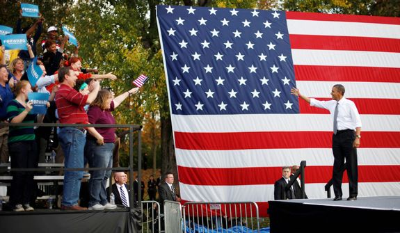 President Barack Obama stops to waves to supporters as he takes the stage during a campaign event at Triangle Park in Dayton, Ohio, Tuesday, Oct. 23, 2012, the day after the last presidential debate against Republican Presidential candidate, former Massachusetts Gov. Mitt Romney. (AP Photo/Pablo Martinez Monsivais)