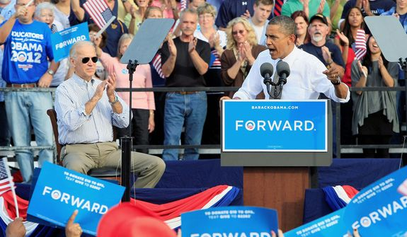 President Barack Obama speaks at a joint campaign rally with Vice President Joe Biden, left,  Tuesday, Oct. 23, 2012, at Triangle Park in Dayton. (AP Photo/Al Behrman)