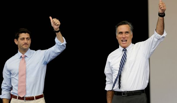 Republican presidential candidate, former Massachusetts Gov. Mitt Romney, right, and  his vice presidential running mate, Rep. Paul Ryan, R-Wis., takes the stage at a campaign event Tuesday, Oct. 23, 2012, in Henderson, Nev. (AP Photo/David Goldman)