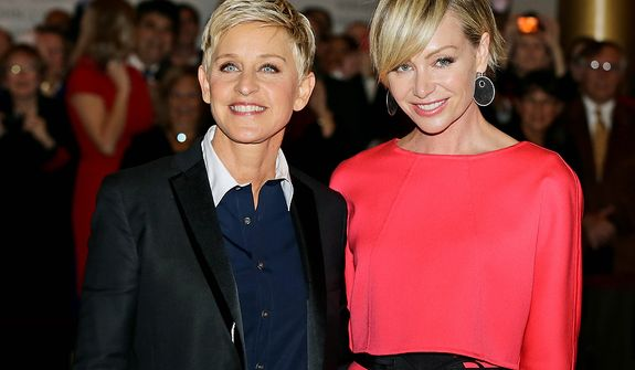 Entertainer Ellen DeGeneres, left, with her wife Portia de Rossi, pose for photographers on the red carpet before DeGeneres receives the 15th annual Mark Twain Prize for American Humor at the Kennedy Center, Monday, Oct. 22, 2012, in Washington. (AP Photo/Alex Brandon)