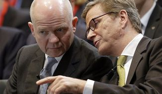 German Foreign Minister Guido Westerwelle, right, and Britain's Foreign Secretary William Hague, left, speak during the '2nd Berlin Foreign Policy Forum' in Berlin, Germany, Tuesday, Oct. 23, 2012. (AP Photo/Michael Sohn)