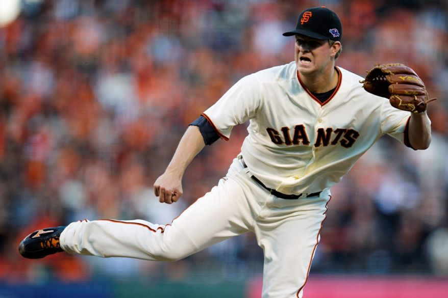 San Francisco Giants starting pitcher Matt Cain delivers a pitch against the St. Louis Cardinals during Game 7 of the National League Championship Series on Oct. 22, 2012, in San Francisco. (Associated Press/The Sacramento Bee)