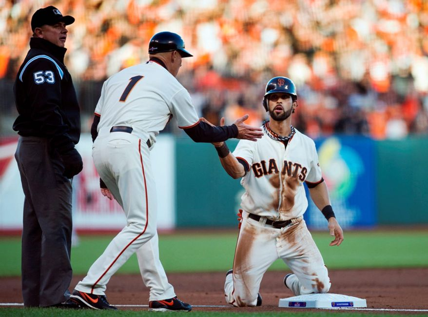 San Francisco Giants CF Angel Pagan is safe after sliding into third base during the first inning of Game 7 of the National League Championship Series between the Giants and the St. Louis Cardinals on Oct. 22, 2012, in San Francisco. (Associated Press/The Sacramento Bee)