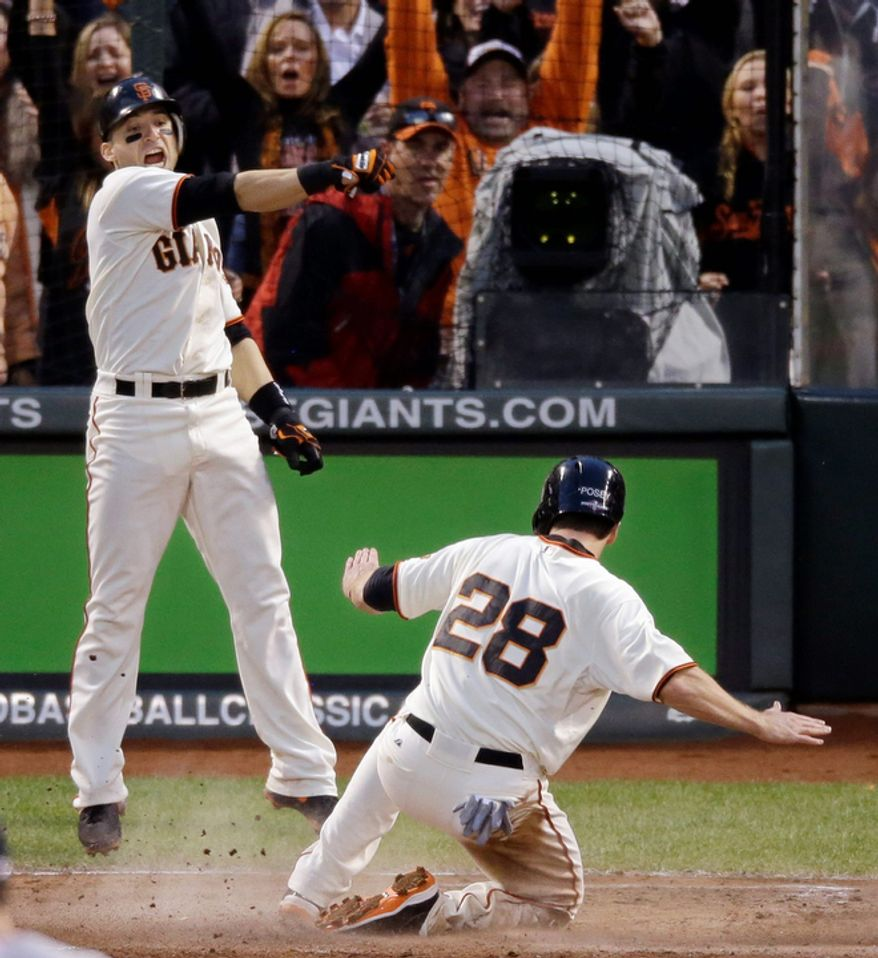 San Francisco Giants 2B Marco Scutaro reacts as Buster Posey (28) scores during the third inning of Game 7 of the National League Championship Series between the Giants and the St. Louis Cardinals on Oct. 22, 2012, in San Francisco. (Associated Press)