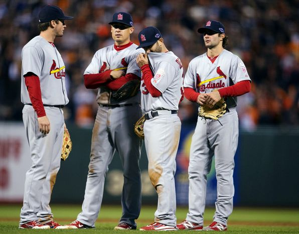 St. Louis Cardinals 2B Daniel Descalso (second from right) waits with others during a pitching change in the third inning of Game 7 of the National League Championship Series between the Giants and the St. Louis Cardinals on Oct. 22, 2012, in San Francisco. (Associated Press/The Sacramento Bee)