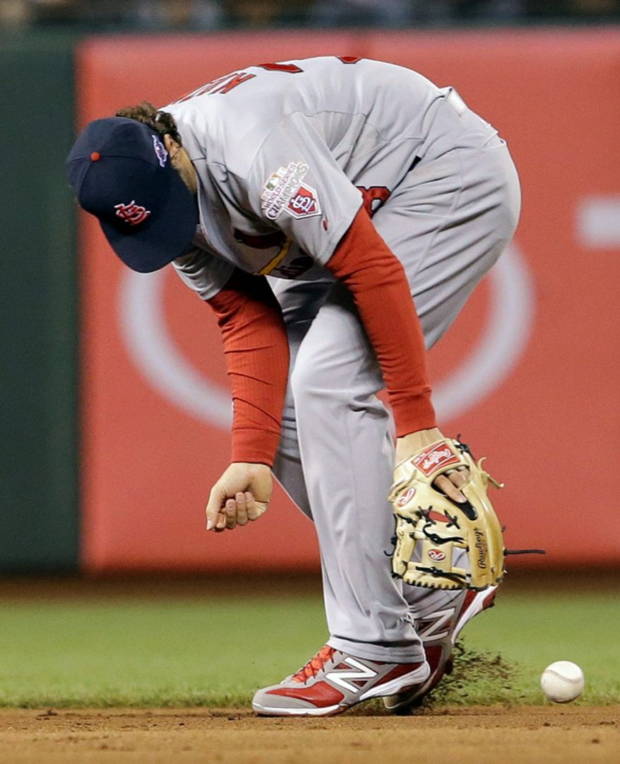 St. Louis Cardinals SS Pete Kozma can't handle a ball hit by San Francisco Giants 3B Pablo Sandoval during the seventh inning of Game 7 of the National League Championship Series between the Giants and the St. Louis Cardinals on Oct. 22, 2012, in San Francisco. (Associated Press)