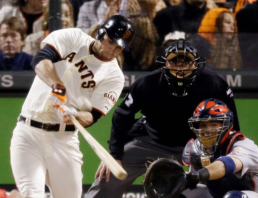 San Francisco Giants 1B Brandon Belt hits a home run during the eighth inning of Game 7 of the National League Championship Series between the Giants and the St. Louis Cardinals on Oct. 22, 2012, in San Francisco. (Associated Press)