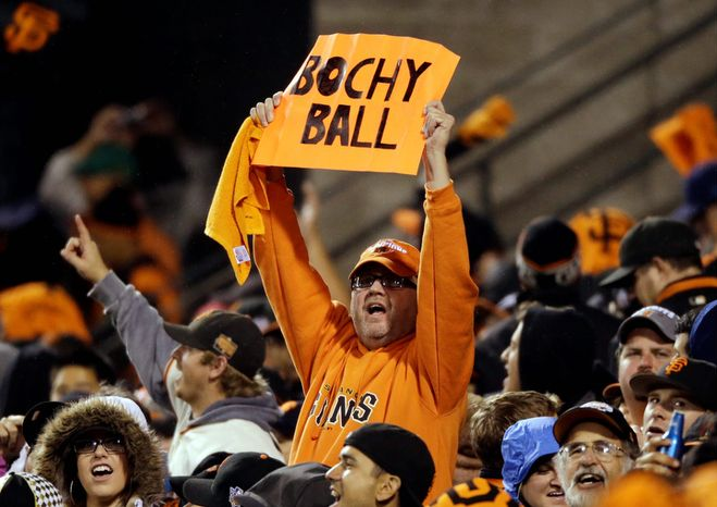 San Francisco Giants fans cheer during the eighth inning of Game 7 of the National League Championship Series between the Giants and the St. Louis Cardinals on Oct. 22, 2012, in San Francisco. (Associated Press)