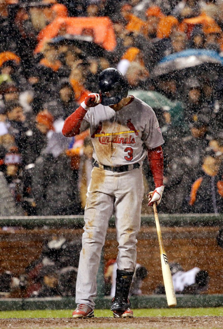 St. Louis Cardinals RF Carlos Beltran bats in the rain during the ninth inning of Game 7 of the National League Championship Series between the Cardinals and the San Francisco Giants on Oct. 22, 2012, in San Francisco. (Associated Press)