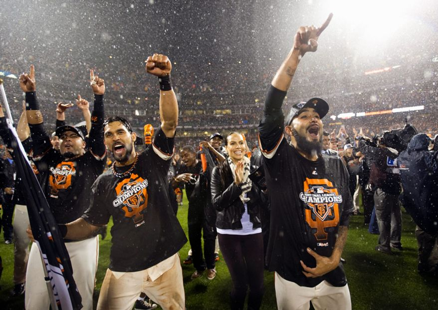 San Francisco Giants RF Gregor Blanco, catcher Hector Sanchez, CF Angel Pagan and pitcher Sergio Romo celebrate on the field following Game 7 of the National League Championship Series between the Giants and the St. Louis Cardinals on Oct. 22, 2012, in San Francisco. The Giants won 9-0. (Associated Press/The Sacramento Bee)