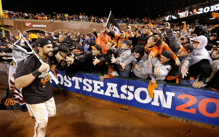 San Francisco Giants CF Angel Pagan celebrates with fans after Game 7 of the National League Championship Series between the Giants and the St. Louis Cardinals on Oct. 22, 2012, in San Francisco. The Giants won 9-0 to win the series. (Associated Press)