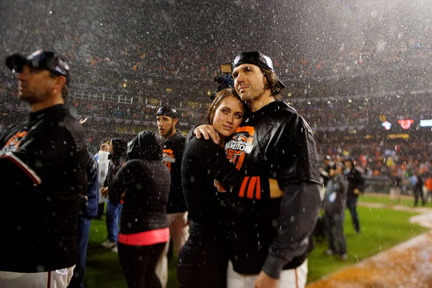 San Francisco Giants pitcher Barry Zito and wife, Amber, embrace following Game 7 of the National League Championship Series between the Giants and the St. Louis Cardinals on Oct. 22, 2012, in San Francisco. The Giants won 9-0. (Associated Press/The Sacramento Bee)