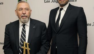 "Ben Affleck (right), a cast member and director of the film ""Argo,"" poses with former CIA agent Tony Mendez, whom Mr. Affleck portrays in the film, backstage at the 16th annual Hollywood Film Awards gala on Monday, Oct. 22, 2012, in Beverly Hills, Calif. (Chris Pizzello/Invision/AP)"