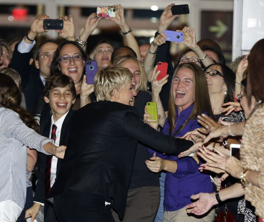 Entertainer Ellen DeGeneres (center) greets fans on the red carpet before receiving the 15th annual Mark Twain Prize for American Humor at the Kennedy Center on Monday, Oct. 22, 2012, in Washington. (AP Photo/Alex Brandon)