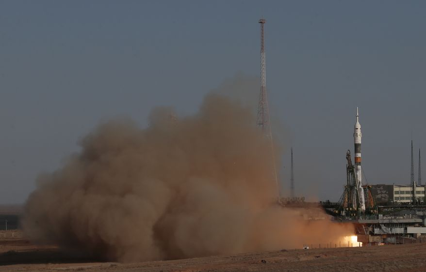 A Soyuz-FG rocket booster with Soyuz TMA-06M space ship carrying a new crew to the International Space Station blasts off from the Russian-leased Baikonur cosmodrome in Kazakhstan on Tuesday, Oct. 23, 2012. (AP Photo/Mikhail Metzel)