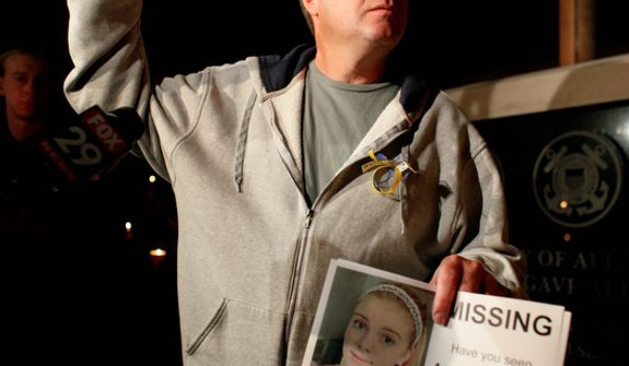 John Spadafore, family member of missing 12-year-old Autumn Pasquale, holds a photo of the girl during a candlelight vigil on Oct. 22, 2012, in Clayton, N.J. (Associated Press)