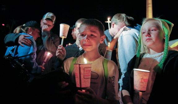 Family members of missing 12-year-old Autumn Pasquale participate in a candlelight vigil on Oct. 22, 2012, in Clayton, N.J. (Associated Press)