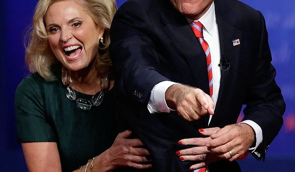Republican presidential nominee Mitt Romney and his wife Ann react towards the audience after the third presidential debate at Lynn University, Monday, Oct. 22, 2012, in Boca Raton, Fla. (AP Photo/Charlie Neibergall)