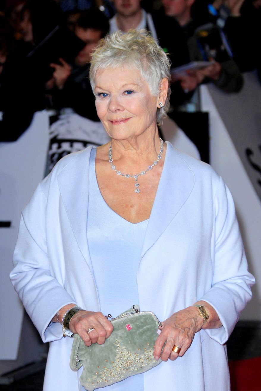 "Dame Judi Dench arrives at the world premiere of ""Skyfall"" at the Royal Albert Hall on Tuesday, Oct. 23, 2012 in London. (Photo by Joel Ryan/Invision/AP)"