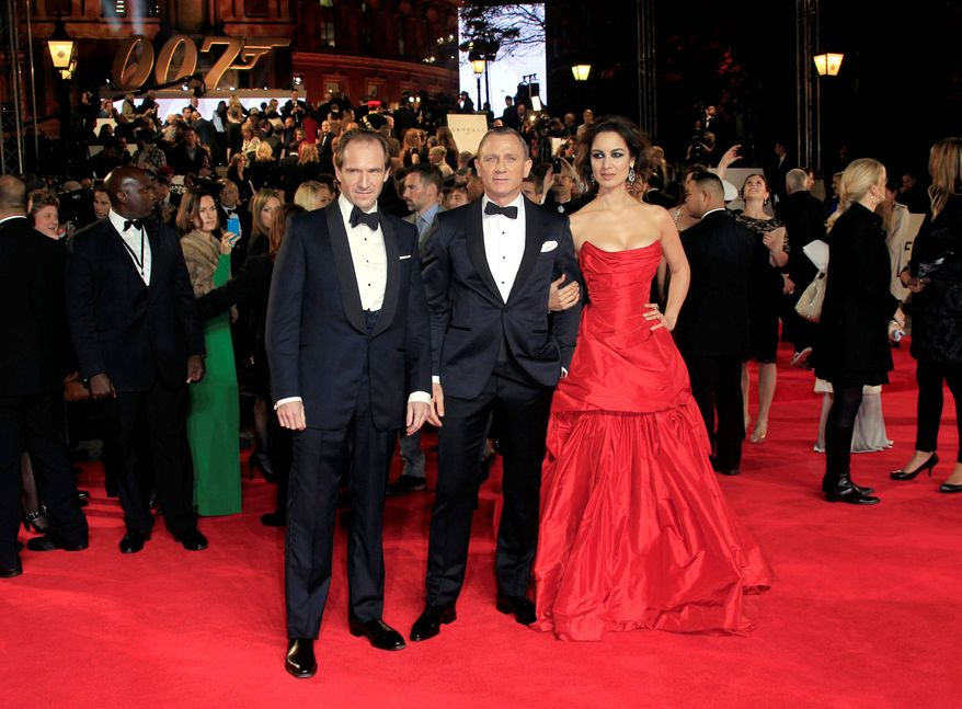 "Actors, from left, Ralph Fiennes, Daniel Craig and BÈrÈnice Marlohe arrive at the world premiere of ""Skyfall"" at the Royal Albert Hall on Tuesday, Oct. 23, 2012 in London. (Photo by Joel Ryan/Invision/AP)"