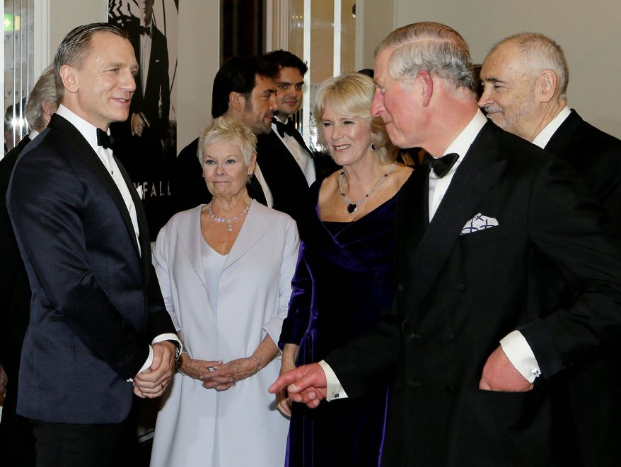 """Britain's Prince of Wales, right, and The Duchess of Cornwall, second right, meet James Bond actor Daniel Craig, left, and Dame Judi Dench, second left, as they arrive to attend the world premiere of the James Bond film, """"Skyfall"""", at the Royal Albert Hall, in London Tuesday, Oct. 23, 2012. (AP Photo/Kirsty Wigglesworth, Pool)"""