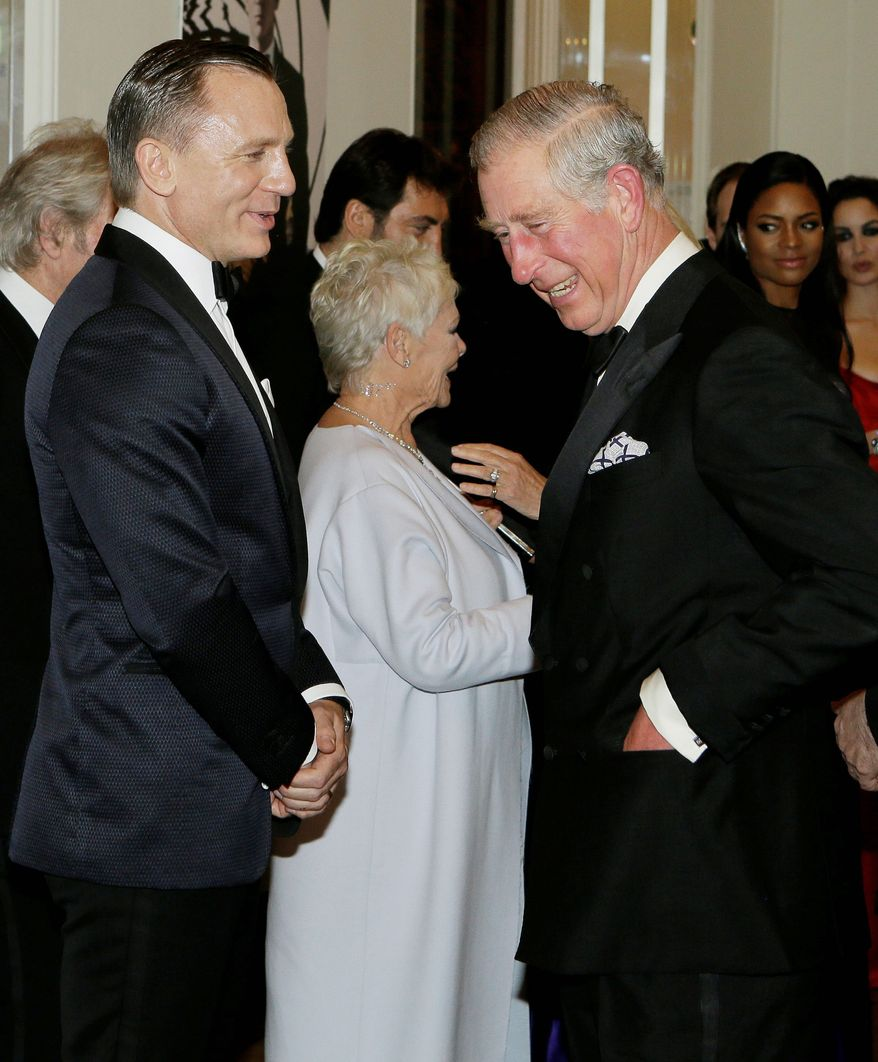 "Britain's Prince of Wales, right, laughs with James Bond actor Daniel Craig, left, as he arrive to attend the world premiere of the James Bond film, ""Skyfall"", at the Royal Albert Hall, in London Tuesday, Oct. 23, 2012. (AP Photo/Kirsty Wigglesworth, Pool)"