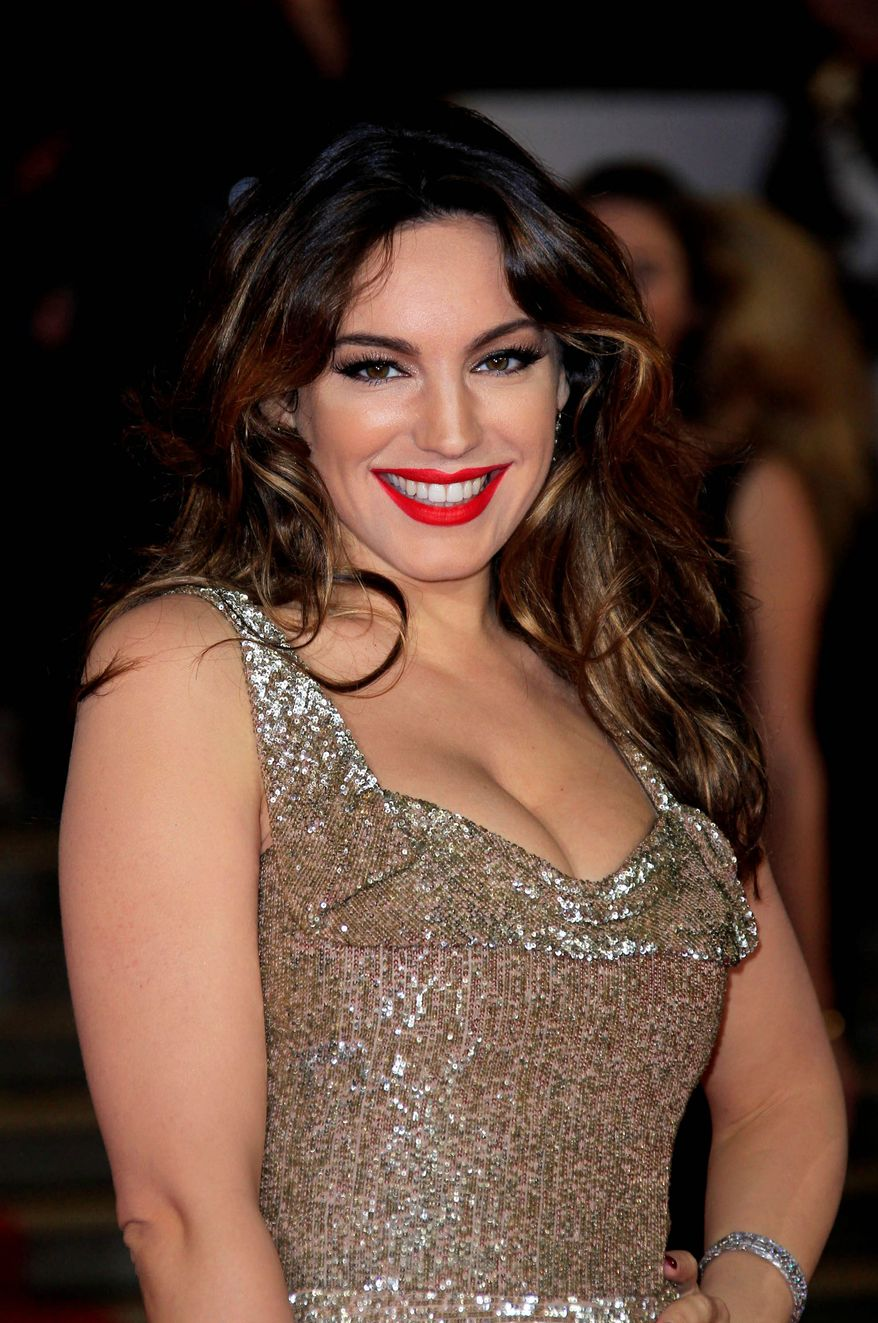 """Kelly Brook arrives at the world premiere of """"Skyfall"""" at the Royal Albert Hall on Tuesday, Oct. 23, 2012 in London. (Photo by Joel Ryan/Invision/AP)"""