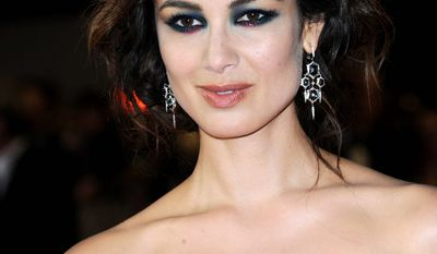 "Berenice Marlohe poses at the world premiere of ""Skyfall"" on Tuesday, Oct. 23, 2012 in London.  (Photo by Stewart Wilson/Invision/AP)"