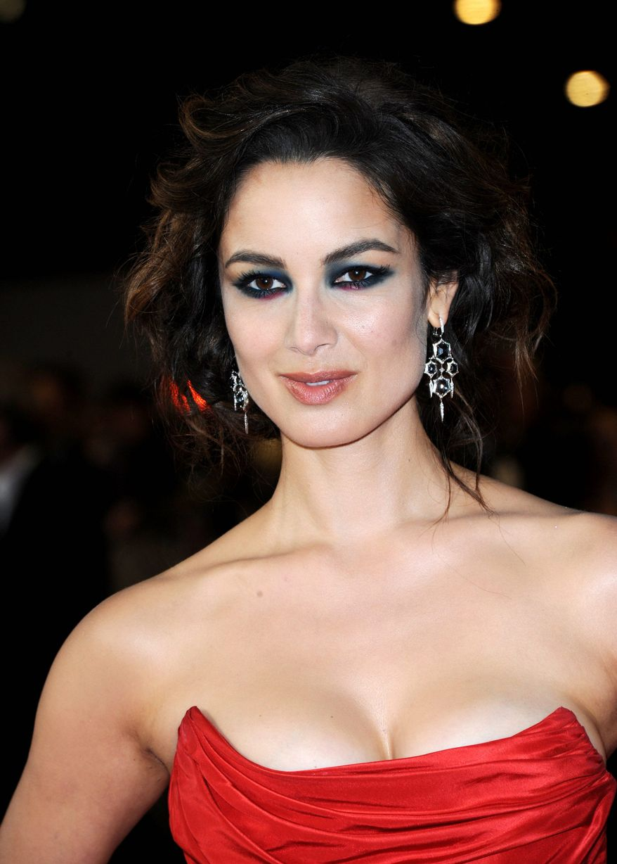 """Berenice Marlohe poses at the world premiere of """"Skyfall"""" on Tuesday, Oct. 23, 2012 in London.  (Photo by Stewart Wilson/Invision/AP)"""