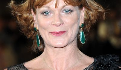 """Samantha Bond arrives at the world premiere of """"Skyfall"""" on Tuesday, Oct. 23, 2012 in London.  (Photo by Stewart Wilson/Invision/AP)"""