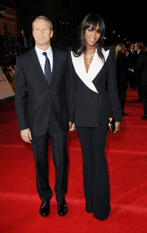"""Russian real estate entrepreneur Vladislav Doronin (left) and model Naomi Campbell arrive at the world premiere of """"Skyfall"""" at the Royal Albert Hall on Tuesday, Oct. 23, 2012, in London. (Stewart Wilson/Invision/AP)"""