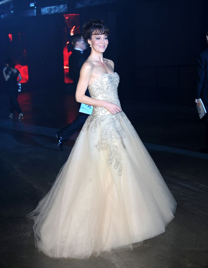 """Helen McCrory poses at the """"Skyfall"""" premiere after party at Tate Modern on Tuesday, Oct. 23, 2012 in London. (Photo by Stewart Wilson/Invision/AP)"""