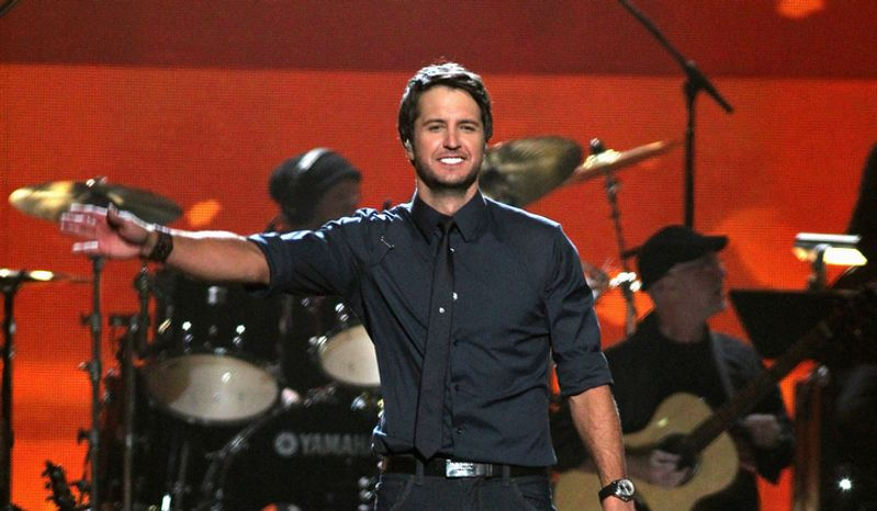 """**FILE** Luke Bryan performs """"Running with the Night"""" at """"ACM Presents: Lionel Richie and Friends in Concert in Las Vegas"""" on April 2, 2012. (Associated Press)"""