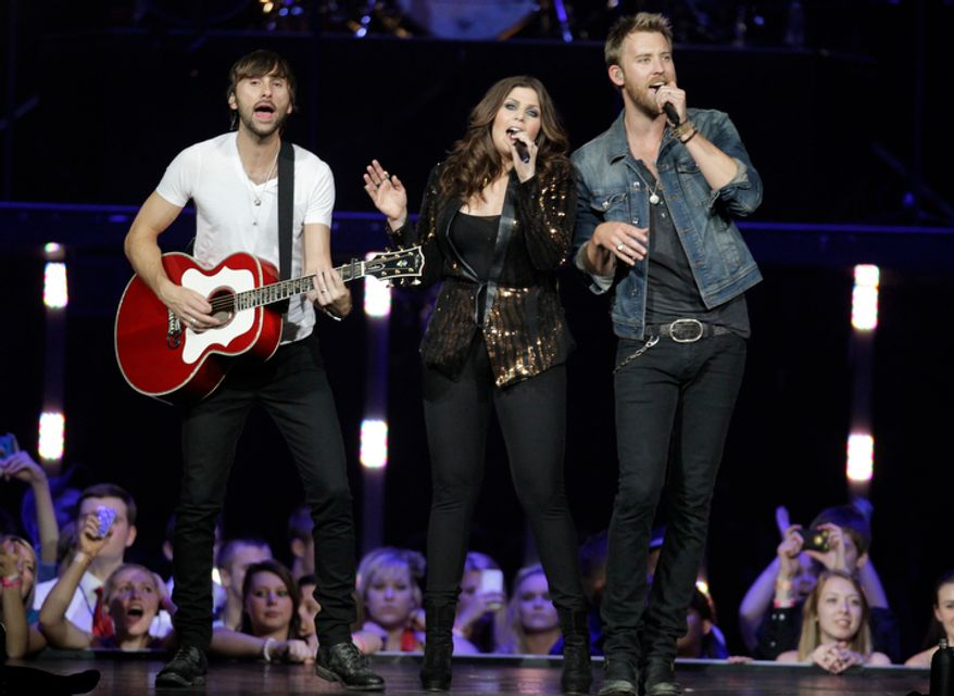 **FILE** Lady Antebellum's Charles Kelly (left), Dave Haywood (right) and Hillary Scott perform May 16, 2012, in Louisville, Ky. (Associated Press)