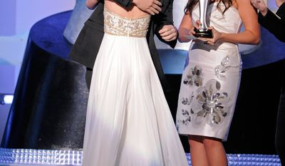 **FILE** Lady Antebellum presents Taylor Swift the award for top new female vocalist at the 43rd Annual Academy of Country Music Awards in Las Vegas on May 18, 2008. (Associated Press)