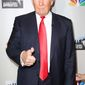 "** FILE ** This image released by Starpix shows businessman and TV host Donald Trump posing at the cast announcement for his new ""All Star Celebrity Apprentice,"" Friday, Oct. 12, 2012, in New York. (AP Photo/Starpix, Kristina Bumphrey)"