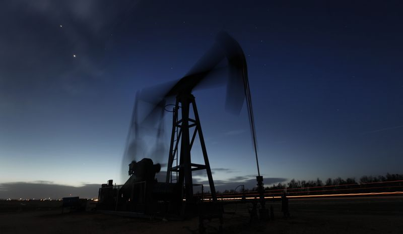 **FILE** A pumping unit sucks oil from the ground near Greensburg, Kan., on March 6, 2012. (Associated Press)