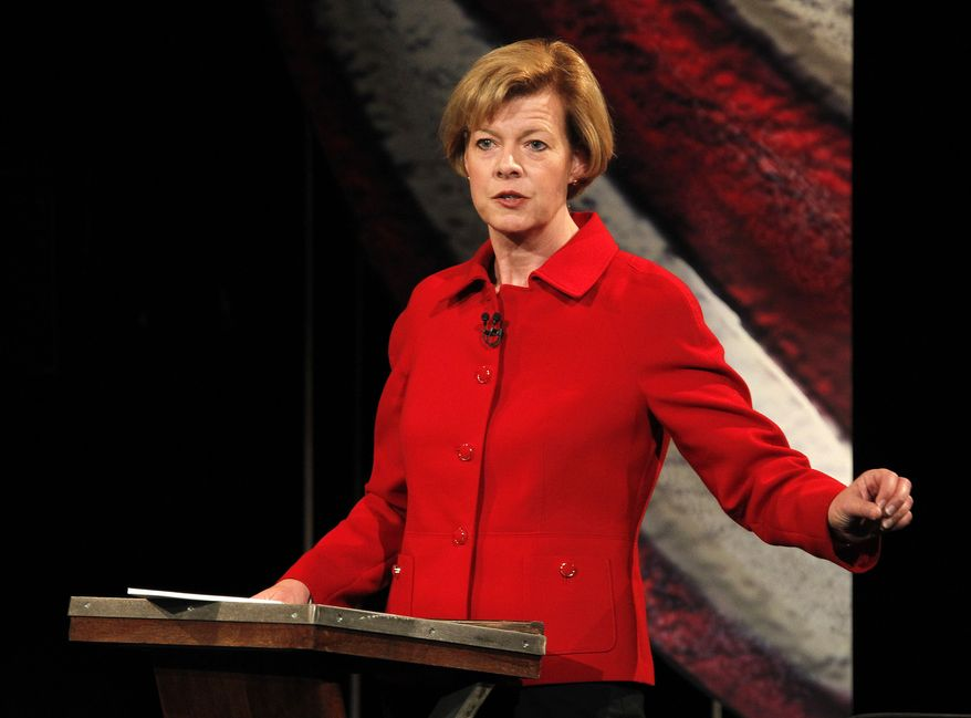 Democratic candidate for Wisconsin's U.S. Senate seat, U.S. Rep. Tammy Baldwin, participates in a debate against Republican candidate former Gov. Tommy Thompson held at the Wisconsin Institute for Public Policy and Service on the University of Wisconsin Marathon County campus in Wausau, Wis., Thursday, Oct. 18, 2012. (AP Photo/Milwaukee Journal Sentinel, Gary Porter, Pool)
