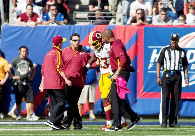 Losing tight end Fred Davis for the season to an Achilles injury is a blow, but the offense should be able to keep functioning at a high level because of the way the Redskins spread the ball around. (Craig Bisacre/The Washington Times)