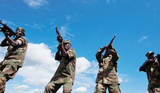 Uganda People's Defense Force (above) take weapons training at the Singo training facility in Kakola, Uganda. A multinational effort can claim a degree of success against al-Shabab fighters, shown conducting their own training in 2011 (left). (The Associated Press)
