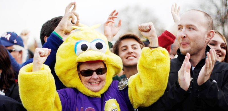 A backer of President Obama shows her support by dressing in a Big Bird costume to cheer during a campaign event at City Park in Denver on Wednesday. (Associated Press)
