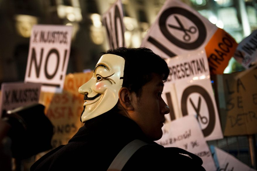 Protestors attend an assembly in Madrid on Oct. 23, 2012, during a demonstration outside Parliament as lawmakers debate budget spending cuts for 2013. (Associated Press)