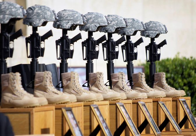 A memorial to victims of the Fort Hood shooting is shown on Nov. 10, 2009, before the start of a memorial service attended by President Obama at Fort Hood, Texas. (AP Photo/Donna McWilliam)