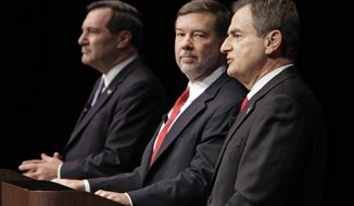 ** FILE ** The candidates for Indiana's U.S. Senate seat — (from left) Democratic Rep. Joe Donnelly, Libertarian Andrew Horning and Republican state Treasurer Richard Mourdock — debate in New Albany, Ind., on Tuesday, Oct. 23, 2012. (AP Photo/Michael Conroy)