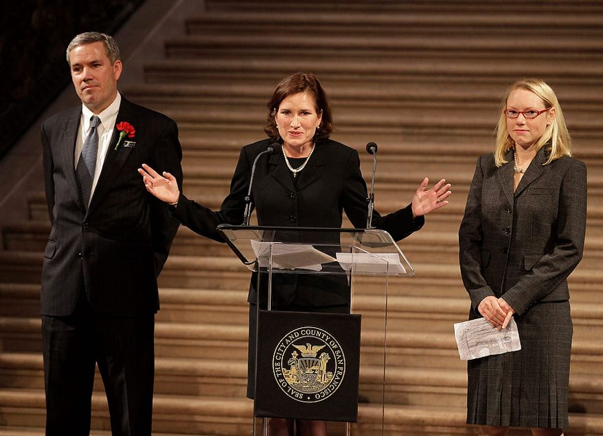 Tom Stevens (left), Anne Stevens Sullivan (center) and Hilary Stevens Koziol, siblings of slain U.S. Ambassador J. Christopher Stevens, speak Oct. 16, 2012, about their brother during a public memorial in the rotunda at City Hall in San Francisco. Stevens, 52, and three other Americans were killed Sept. 11 when gunmen attacked the United States Mission in Benghazi, Libya. (Associated Press